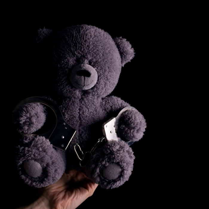 teddy bear in handcuff. child crime concept